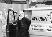 Rioting, The Bogside, Derry, Northern Ireland 1981. Hijacker wearing a white mask leaving a stolen local butchers van so it can be set on fire. IRA prisoner Bobby Sands had just died after a hunger st... - David Mansell - 1980s,1981,butchers,Catholic,Catholics,cities,City,Conflict,Conflicts,Derry,highway,hunger,INMATE,INMATES,IRA,Ireland,Irish,leaving,local,Londonderry,male,man,mask,masked,masks,men,nationalism,nationa