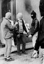 Rioting, The Bogside, Derry, Northern Ireland 1981 masked youths preparing molotov cocktails. IRA prisoner Bobby Sands had just died after a hunger strike - David Mansell - 06-05-1981