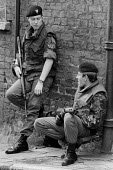 British Army patrolling the streets of the protestant enclave of the Fountains area, Derry, Northern Ireland 1978 - David Mansell - 1970s,1978,Annual Londonderry Apprentice Boys parade,armed,Armed Forces,arms,army,British Army,Catholic,Catholics,cities,City,communicating,communication,Conflict,Conflicts,conversation,conversations,