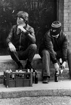 Rioting, The Bogside, Derry, Northern Ireland 1981 masked youths preparing molotov cocktails. IRA prisoner Bobby Sands had just died after a hunger strike - David Mansell - 06-04-1981