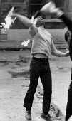 Masked youths throwing petrol bombs at soldiers, The Bogside, Derry, Northern Ireland 1981. IRA prisoner Bobby Sands had just died after a hunger strike - David Mansell - 06-04-1981