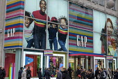 Gap Store, End of year sales, Oxford Street, London - Philip Wolmuth - 2010s,2018,apparel,BAME,BAMEs,Black,BME,bmes,bought,business,buy,buyer,buyers,buying,cities,city,clothes,clothing,commodities,commodity,consumer,consumers,crowd,crowds,customer,customers,diversity,EBF