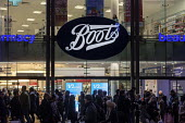 Boots store. End of year sales, Oxford Street, London - Philip Wolmuth - 2010s,2018,Boots,bought,business,buy,buyer,buyers,buying,chemist,cities,city,commodities,commodity,consumer,consumers,crowd,crowds,customer,customers,EBF,Economic,Economy,evening,goods,high street,Lon