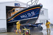 RNLI crew cleaning lifeboat, Dungeness Lifeboat station, Kent - Jess Hurd - 2010s,2019,accident,accidental,accidents,boat,boats,cleaning,cleansing,crew,DIA,Dungeness,Dungeness Lifeboat Station,emergency,employee,employees,Employment,English Channel,incident,incidents,jet,jets