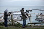 Press photographing the boarder patrol boat Searcher, looking for refugees crossing the Channel Channel from France, New Years Day, Port of Dover, Kent. - Jess Hurd - 2010s,2019,boarder,boat,BOATS,camera,cameras,cross,crosses,crossing,diaspora,displaced,employee,employees,Employment,English Channel,foreign,foreigner,foreigners,France,freelance,freelances,french,ill