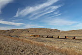 Nebraska Sandhills, USA, BNSF coal train. Each day as many as 100 coal trains, each about a mile long, carry coal from Powder River Basin, Wyoming to power stations across the country - Jim West - 2010s,2018,BNSF,Burlington Northern Santa Fe,capitalism,cargo,coal,Coal Industry,coal train,coalfield,coalindustry,EBF,Economic,Economy,energy,engine,engines,fossil fuel,freight,goods train,Industries