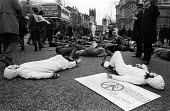 CND 4 Minute die in protest, Ministry of Defence, Whitehall 1984, blocking traffic in a campaign of nonviolent civil disobedience against nuclear weapons and the arms race London 1984 - Stefano Cagnoni - 04-03-1984