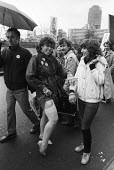 Trrade union rights at GCHQ protest, London 1984 Women showing off her stocking clad legs bearing a sticker in support - Stefano Cagnoni - 28-02-1984