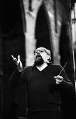 Polish composer Krzysztof Penderecki rehearsing 1984 the first British performance of Te Deum with the Krakow Symphony Orchestra at the Brighton Festival - Stefano Cagnoni - 1980s,1984,ACE,Arts,baton,classical music,composer,Composers,concert,concerts,conducting,conductor,conductors,culture,Festival,FESTIVALS,Krakow,Krzystof Pendercki,male,man,melody,men,music,MUSICAL,Orc