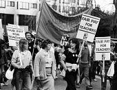 NUT Fair Pay For Teachers protest London 1984 during an one day strike - Stefano Cagnoni - 1980s,1984,activist,activists,against,banner,banners,CAMPAIGNING,CAMPAIGNS,DEMONSTRATING,demonstration,Fair,fair pay,FEMALE,industrial dispute,London,member,member members,members,NUT,paid,pay,people,