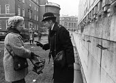 Police cautioning Christian CND activist London 1987 before arresting her for painting symbols on the wall of the Ministry of Defence, anonviolent direct action in protest against the normalisation of... - Stefano Cagnoni - 1980s,1987,activist,activists,admonishment,adult,adults,against,Anti War,Antiwar,arrest,arrested,arresting,atomic,Belief,CAMPAIGN,Campaign for Nuclear Disarmament,campaigner,campaigners,CAMPAIGNING,CA