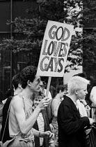 Gay Pride celebration London 1987. God Loves Gays placard - Stefano Cagnoni - 27-06-1987