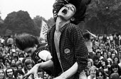 Hippy dancing, pop music festival Hyde Park London 1971 Wearing a Release badge - the charity with expertise on drugs and drugs law - Chris Davies - 04-09-1971
