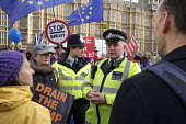 Police officers cautioning pro Brexit campaigners over confrontational behaviour outside the Houses of Parliament as MPs start five days of debate on the withdrawal agreement with the EU, Westminster,... - Philip Wolmuth - 2010s,2019,activist,activists,adult,adults,against,Brexit,Brexiters,CAMPAIGN,campaigners,CAMPAIGNING,CAMPAIGNS,CLJ,crime,DEMONSTRATING,demonstration,EU,European Union,flag,flags,force,Houses,law and o