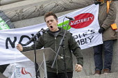 Owen Jones speaking Britain is Broken - General Election Now, People's Assembly protest, Trafalgar Square, London - Jess Hurd - People's Assembly Against Austerity,2010s,2019,activist,activists,against,Assembly,Austerity Cuts,banner,banners,Brexit,Britain is Broken - General Election Now,Broken,campaigner,campaigners,CAMPAIGNI