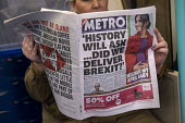 Metro newspaper headline: Will History Ask.. Did We Deliver Brexit? reading on the tube as MPs prepare to vote on Brexit deal, Westminster, London - Jess Hurd - 2010s,2019,bank,BANKS,Brexit,carriage,carriages,day,Deliver,democracy,dominant narrative,EBF,Economic,Economy,EU,European Union,Historic,HSBC,journalism,journey,journeys,London,media,Metro,MP,MPs,news