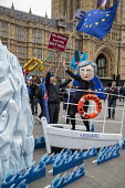 Avaaz Titanic steered by Theresa May with a People's Vote lifebuoy protest as Parliament prepares to vote on Brexit, Westminster, London. Avaaz joint campaign with Best for Britain and Hope Not Hate c... - Jess Hurd - 2010s,2019,activist,activists,against,Avaaz,Avaaz campaign,Best for Britain,Brexit,campaign,campaigning,CAMPAIGNS,day,democracy,DEMONSTRATING,demonstration,DEMONSTRATIONS,EU,European Union,FEMALE,flag