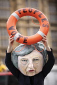 Avaaz Titanic steered by Theresa May with a People's Vote lifebuoy protest as Parliament prepares to vote on Brexit, Westminster, London. Avaaz joint campaign with Best for Britain and Hope Not Hate c... - Jess Hurd - 2010s,2019,activist,activists,against,Avaaz,Avaaz campaign,Best for Britain,Brexit,campaign,campaigning,CAMPAIGNS,day,democracy,DEMONSTRATING,demonstration,DEMONSTRATIONS,EU,European Union,FEMALE,Hope