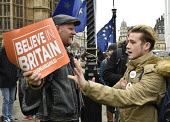 Protest as Parliament prepares to vote on Brexit, Westminster, London. Young man supporting Brexit right angry with Remain supporter (L) who snatched his poster from his hands - Stefano Cagnoni - 2010s,2019,activist,activists,against,argue,arguing,argument,Brexit,CAMPAIGNING,CAMPAIGNS,communicating,communication,conversation,conversations,deal,debate,debating,DEMONSTRATING,demonstration,dialog