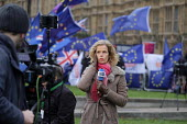 Deutsche Welle (DW) news presenter, College Green as Parliament prepares to vote on Brexit, Westminster, London - Philip Wolmuth - 2010s,2019,activist,activists,against,Brexit,broadcast,broadcaster,broadcasters,BROADCASTING,camera,cameras,CAMPAIGNING,CAMPAIGNS,College,COLLEGES,communicating,communication,DEMONSTRATING,Demonstrati