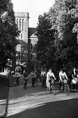 Girton College Cambridge 1959 Women science undergraduates setting off from Girton to cycle into the city - Kurt Hutton - 1950s,1959,bicycle,bicycles,BICYCLING,Bicyclist,Bicyclists,BIKE,BIKES,Cambridge,College,COLLEGES,course,courses,cycle,cycles,cycling,Cyclist,Cyclists,degree,degrees,EDU,educate,educating,education,edu
