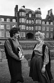 Newnham College Cambridge 1959 Women science undergraduates talking outside the Pfeiffer Building. Penelope Stearn studying Biochemistry (L) and Claire Martyn studying Botany(R) - Kurt Hutton - 1950s,1959,architecture,buildings,Cambridge,College,COLLEGES,communicating,communication,conversation,course,courses,degree,degrees,dialogue,EDU,educate,educating,education,educational,female,Higher E