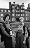 Newnham College Cambridge 1959 Women science undergraduates talking outside the Pfeiffer Building, Penelope Stearn studying Biochemistry (L) and Claire Martyn studying Botany(R) - Kurt Hutton - 1950s,1959,architecture,Building,buildings,Cambridge,College,COLLEGES,communicating,communication,conversation,course,courses,degree,degrees,dialogue,EDU,educate,educating,education,educational,female