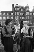 Newnham College Cambridge 1959 Women science undergraduates talking between lectures outside the Pfeiffer Building, (L to R) Penelope Stearn Biochemistry, Tessa Rudebeck Natural Sciences and Claire Ma... - Kurt Hutton - 1950s,1959,architecture,Building,buildings,Cambridge,College,COLLEGES,communicating,communication,conversation,conversations,course,courses,degree,degrees,dialogue,discourse,discuss,discusses,discussi