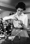 Girton College Cambridge 1959 Ann Carr a science student studying the arrangement of atoms in crystals, Downing laboratory - Kurt Hutton - 1950s,1959,assembling,atoms,atoms: interatomic forces,building,BUILDINGS,Cambridge,College,COLLEGES,course,courses,crystal,crystalline,crystallography,crystalography,degree,degrees,EDU,educate,educati
