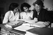 Girton College Cambridge 1959 Women Physics student Catherine Hawarth and overseas student Gohar Ebrahinzadeh in a supervised revision session led by Dr Helen Megaw Fellow of Girton College and Direct... - Kurt Hutton - 17-09-1959
