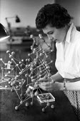 Girton College Cambridge 1959 Ann Carr a science student studying the arrangement of atoms in crystals in the Downing laboratory - Kurt Hutton - 1950s,1959,assembling,atoms,atoms: interatomic forces,building,BUILDINGS,Cambridge,College,COLLEGES,course,courses,crystal,crystalline,crystallography,crystalography,degree,degrees,EDU,educate,educati