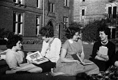 New Hall College Cambridge 1959 Women science undergraduates talking and relaxing in the garden outside their halls - Kurt Hutton - 1950s,1959,BOOK,books,Cambridge,College,COLLEGES,communicating,communication,companions,conversation,conversations,course,courses,degree,degrees,dialogue,discourse,discuss,discusses,discussing,discuss