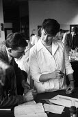 University of Cambridge 1959 Woman Science student Ann Gittings from Newnham College Cambridge working with a laboratory assistant, Lensfield Road chemistry laboratory - Kurt Hutton - 17-09-1959