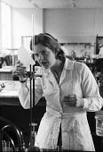 Lensfield Road chemistry laboratory 1959 Woman science student Tessa Rudebeck from Newnham College, Cambridge - Kurt Hutton - 1950s,1959,analysis,Cambridge,chemist,chemistry,College,COLLEGES,course,courses,degree,degrees,EDU,educate,educating,education,educational,equipment,experiment,female,Higher Education,highway,knowledg