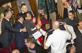 Remain protester is ejected by security, Leave Means Leave Rally, Central Hall Westminster, London - Jess Hurd - 2010s,2019,activist,activists,against,Brexit,campaign,campaigning,CAMPAIGNS,Central Hall,DEMONSTRATING,Demonstration,DEMONSTRATIONS,ejected,EU,European Union,guard,guarding,guards,Leave,Leave means le