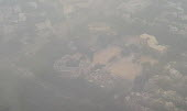 Air pollution in India. Landing in the smog at Delhi airport. Air pollution in India is a serious issue with the major sources being fuelwood and biomass burning, fuel adulteration, vehicle emission a... - Martin Mayer - 2010s,2018,Air Pollution,Air Quality,airport.,building,buildings,BURN,burning,BURNS,cities,City,cityscape,cityscapes,CONGESTED,congestion,Delhi,ENI,environment,environmental degradation,Environmental
