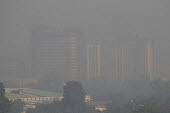Air pollution in India, Delhi. High rise buildings through morning smog. Air pollution in India is a serious issue with the major sources being fuelwood and biomass burning, fuel adulteration, vehicle... - Martin Mayer - 2010s,2018,Air Pollution,Air Quality,blocks,building,buildings,BURN,burning,BURNS,capital,cities,City,cityscape,cityscapes,CONGESTED,congestion,Delhi,ENI,environment,environmental degradation,Environm