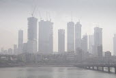 Air pollution in India, Mumbai; construction of high rise buildings in smog. Mumbai as the fourth most polluted city in the world. Air pollution in India is a serious issue with the major sources bein... - Martin Mayer - 28-08-2016