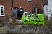 Protect The Town's Green Spaces Protest sign outside a house. Residents are objecting to the selling off of part of the KES playing field, Stratford upon Avon, Warwickshire - John Harris - activist,activists,against,banner,banners,campaign,campaigner,campaigners,campaigning,CAMPAIGNS,DEMONSTRATING,Demonstration,DEMONSTRATIONS,developer,developers,development,ENI,environment,Environmenta