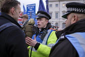 Police speaking to a Brexit protester. Brexit supporters protest, Houses of Parliament as MPs vote on amendments withdrawal deal with the EU, Westminster, London - Philip Wolmuth - 2010s,2019,activist,activists,adult,adults,against,Brexit,CAMPAIGNING,CAMPAIGNS,CLJ,communicating,communication,conversation,conversations,DEMONSTRATING,demonstration,dialogue,discourse,discuss,discus