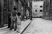 Asian children watching an Anti Nazi League protest passing the end of their street London 1978 - John Sturrock - 1970s,1978,activist,activists,against,ANL,Anti Fascist,Anti Nazi League,Anti Racism,anti racist,Asian,Asians,BAME,BAMEs,Black,BME,bmes,boy,boys,CAMPAIGNING,CAMPAIGNS,child,CHILDHOOD,children,cities,Ci