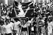 Protest against Apartheid in South Africa London 1986 - Stefano Cagnoni - 1980s,1986,AAM,ACE,activist,activists,Africa,against,Anti Apartheid Movement,Apartheid,Arts,BAME,BAMEs,banner,banners,Black,Black and White,BME,bmes,CAMPAIGNING,CAMPAIGNS,Culture,DEMONSTRATING,Demonst