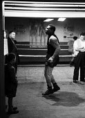 Nigerian boxer Dick Tiger in training at the gym Liverpool 1958 watched by an older man and a young boy. A professional boxer he held the World Middleweight and World Light Heavyweight Championship - Alan Vines - 13-10-1958