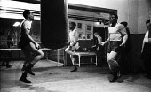 Nigerian boxer Dick Tiger right in training at the gym with other boxers LIverpool 1958 - Alan Vines - 1950s,1958,African,Africans,ANIMAL,ANIMALS,BAME,BAMEs,Bedford Street gym,black,BME,bmes,box,boxer,boxers,boxes,boxing,Dick Tiger,diversity,ethnic,ethnicity,exercise,exercises,exercising,fitness,gym,gy
