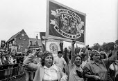 Durham Miners Gala 1986. Anne Scargill and women of the Barnsley Miners Wives Action Group on the traditional Labour movement parade through the City - Stefano Cagnoni - 1980s,1986,activist,activists,against,banner,banners,Big Meeting,CAMPAIGNING,CAMPAIGNS,DEMONSTRATING,demonstration,DMA,Durham Miners Gala,equal rights,equality,female,feminism,feminist,feminists,membe