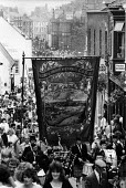 Durham MIners Gala 1986. COSA Banner on the traditional Labour movement parade through the City - Stefano Cagnoni - 1980s,1986,activist,activists,against,bagpipes,banner,banners,Big Meeting,CAMPAIGNING,CAMPAIGNS,communities,community,COSA,DEMONSTRATING,demonstration,DMA,Durham Miners Gala,history,male,man,melody,me