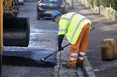 Road Maintenance workers repairing the road, Bristol - Paul Box - 2010s,2019,application,applied,applying,ASPHALT,by hand,cities,City,contractor,contractors,EBF,Economic,Economy,employee,employees,Employment,highway,job,jobs,lay,laying,LBR,machine,machinery,machines
