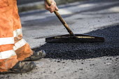 Road Maintenance workers repairing the road, Bristol - Paul Box - 2010s,2019,application,applied,applying,ASPHALT,by hand,cities,City,contractor,contractors,EBF,Economic,Economy,employee,employees,Employment,highway,job,jobs,lay,laying,LBR,maintaining,maintenance,pe