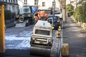 Road Maintenance workers repairing the road, Bristol - Paul Box - 2010s,2019,application,applied,applying,ASPHALT,cities,City,contractor,contractors,EBF,Economic,Economy,employee,employees,Employment,highway,job,jobs,lay,laying,LBR,machine,machinery,machines,maintai