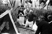 Royal Swan Upping 1959. Dating back to the 12th Century an annual census of the swan population by the Queen's swan uppers on a particular stretch of the River Thames to check the health of and count... - Alan Vines - 1950s,1959,ACE,age,ageing population,animal,animals,bird,birds,boat,boats,catch,catching,census,ceremonial,ceremonies,ceremony,count,counting,Culture,cygnet,cygnets,elderly,ENI,environment,Environment